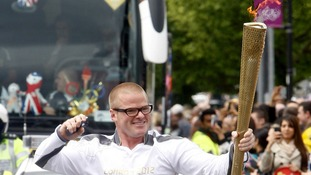 Heston Blumenthal carries the Olympic Torch through Slough.