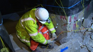 A demolition man wiring up the explosives two days before today's blast