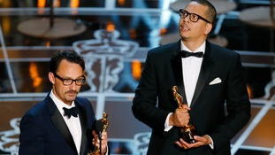 Director and writer Mat Kirkby and writer James Lucas accept the Oscar for the best live action short film The Phone Call.