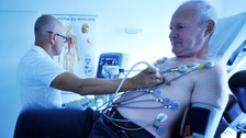 A patient having their heart monitored