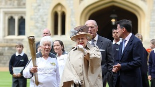 The Queen enjoys the visit of the Olympic Torch.