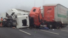 Wreckage of lorries on M1 after multiple pile-up