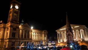 Night view of Victoria Square with Christmas trees and German market stalls