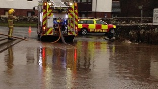 Firefighters at the scene pumping out water