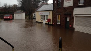 Businesses at Warwick Bridge cut off by water