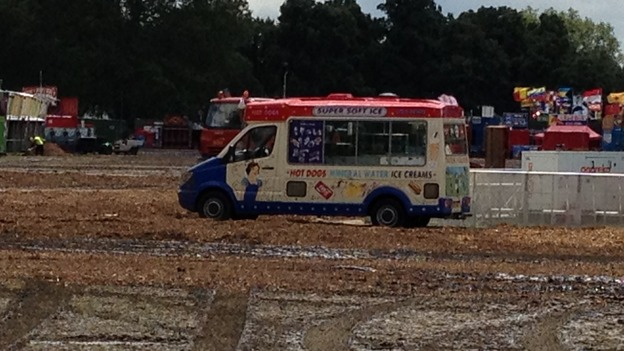 An ice cream van stranded in the mud.
