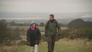 Archaeologist Fiona Gale and Coast & Country presenter Andrew Price walking up Moel Y Gaer