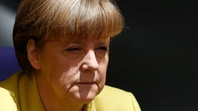 Angela Merkel's party has overwhelmingly backed the extension of Greece's bailout despite dissension from within their ranks and in the German press.