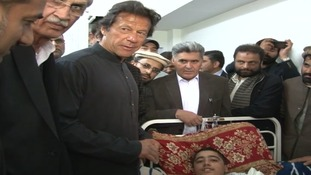 Ahmad with Imran Khan
