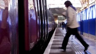 Woman boarding train