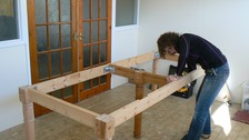 Dwynwen making a table
