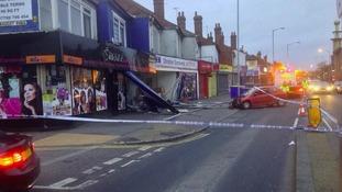 Car crashed into shops