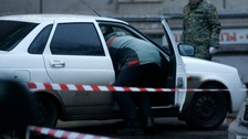 Police search the suspicious vehicle in central Moscow.
