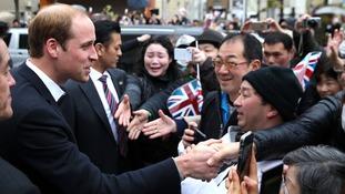 The Duke of Cambridge meets crowds of public.