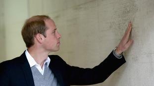 The Duke of Cambridge examines the 2011 Tsunami high tide mark.