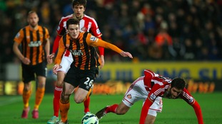Hull City's Andy Robertson and Sunderland's Danny Graham (right) battle for the ball during the Barclays Premier League match at the KC Stadium, Hull.