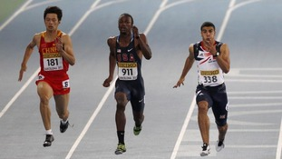 Adam Gemili of Britain runs to win ahead of Xie Zhenye of China and Aaron Ernest of the USA