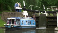 A boat coming through lock gates at Hatton Locks in Warwickshire