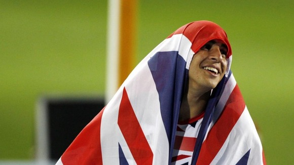 Gemili celebrates by wrapping himself in a Union Jack.