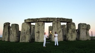 Olympic torch lights up Stonehenge