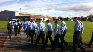 Air Cadets in uniform getting ready for their role in today's visit