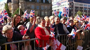 Crowds of well wishers in Victoria Square waiting for the Queen's arrival at 10:00am