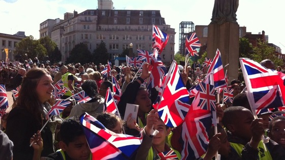 Crowds building in a sunny Victoria Square for Queen&#x27;s visit