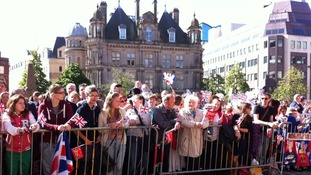 People waiting at the barriers to see The Queen and The Duke of Edinburgh