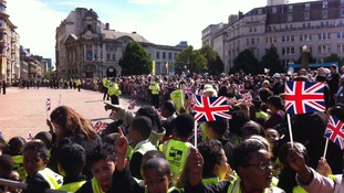 Hundreds of schoolchildren wait for Royal party to arrive in Victoria Square