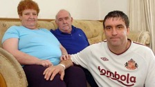 Man with parents on sofa