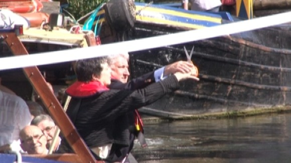 Ribbon being cut over a canal in Birmingham to mark the handover to the Canal &amp; River Trust