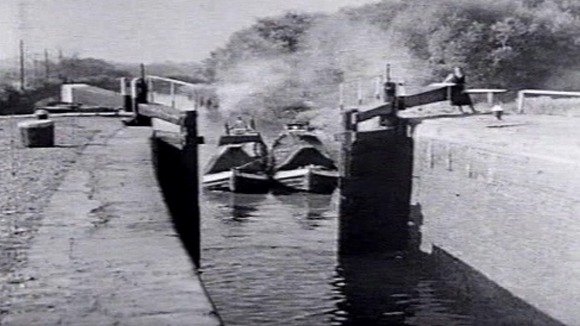 Archive pictures of boats using the Grand Union Canal to carry freight