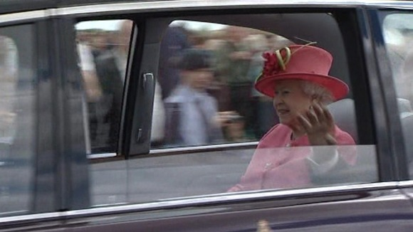 The Queen waves to crowds at RAF Cosford