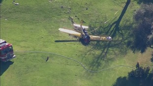 Helicopter pictures show the plane after impact.