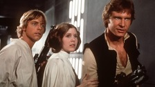 Hamill (left) alongside Carrie Fisher (centre) and Ford (right) in Return of the Jedi.