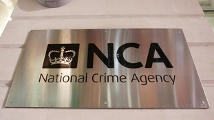 A sign outside the offices of the National Crime Agency (NCA) in London