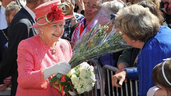 The Queen accepts some flowers