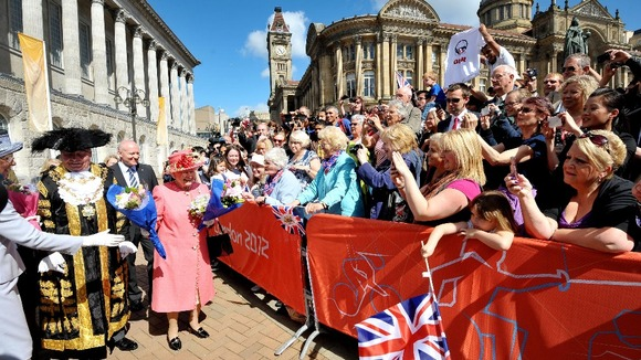 The crowds celebrate as The Queen arrives in Birmingham