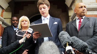 Kane Gorny's  mother Rita Cronin stands by the side of her lawyer, James Stevens,
