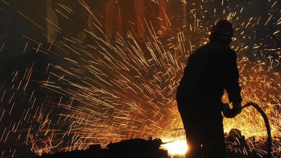 Labourers work at a steel manufacturing plant in Hefei, Anhui province.