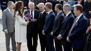 Kate is welcomed by Lord Fellowes as she arrives at Ealing Studios.