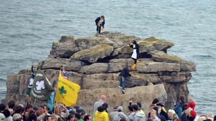 Police pick up penguins at torch relay start