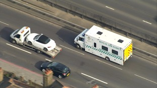 An ambulance carrying the healthcare worker is on route to hospital.