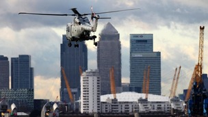 A Royal Marines helicopter hovers over the River Thames during an exercise earlier this year.