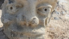 The stone head discovered in the ruin