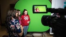 ITV Cymru Wales Weather Presenter Kate Lewis helps students try out the forecast