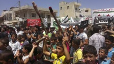 Demonstrators protest against Syria's President Bashar al-Assad after Friday Prayers in Binsh near Idlib