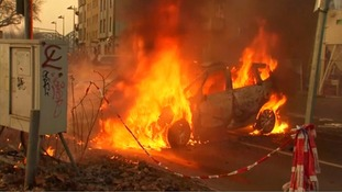 Police cars have been set alight