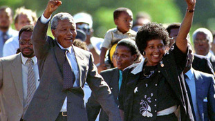 Mandela is accompanied by his former wife Winnie, moments after his release from prison in this February 11, 1990