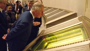 Prince Charles looks at the Declaration of Independence.